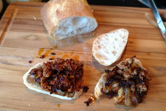 Tasting fresh chorizo with caramelized onions and ciabatta